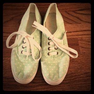 Green and white polka dot keds